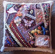 Beautiful crazy quilt pillow. Could use satins and lace scraps