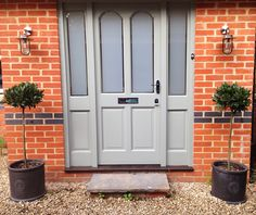Front door, reglazed and painted Farrow & Ball Pigeon Grey. Astro Montparnasse Light Fixtures and a pair of Bays in Kew Gardens slate pots. Finished with chrome furniture. Now for the rest of the house!!