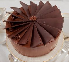 Dobos Torte is a multilayered cake sponge cake filled with an intense chocolate buttercream made famous by an Hungarian confectioner, József C. Dobos.