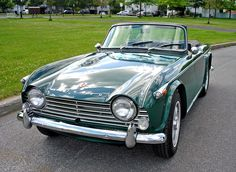1966 Triumph TR4A IRS / Designer: Giovanni Michelotti  / Color: British Racing Green / One can't claim to have driven an automobile (despite years of driving experience) until one drives a classic sport car.
