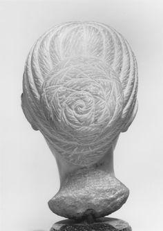Anonymous artist, Head of a Woman. This head has the highly polished surface distinctive of the Antonine period and a part of the original hairstyle at the nape of the neck, but the piece was drastically re-carved in the late 3rd to early 4th century. In the harsh economic climate of the late Roman period, earlier sculptures were often re-worked in order to save both marble and time. Original: 138-192. Recarved: late 3rd-4th century