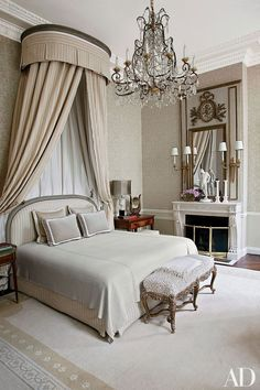The bed in the master suite of a Paris home renovated by interior designer Jean-Louis Deniot is highlighted by an 18th-century corona and a Louis XV bench; the chandelier is 1880s Italian, and 1940s Jansen sconces flank the Louis XVI trumeau.