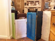 I like the different colors better!  Dog gate fashioned from vintage shutters.  (Menard's has shutters for $16.99)
