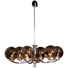 Kaiser Leuchten Chromed Chandelier with six Mouth-Blown Crystal Mazzenga Globes | From a unique collection of antique and modern Chandeliers and Pendants at https://www.1stdibs.com/furniture/lighting/chandeliers-pendant-lights/.