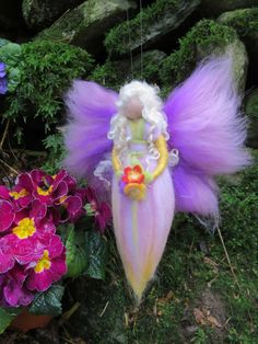 Spring Fairy: Primrose    This fairy is handmade by using the needle felt technique. She is made of soft, high quality merino wool in magical