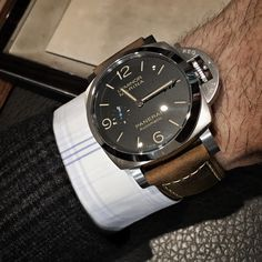 Instagram- newcavendishjewellers- Monday got me like...client picks up the PAM 1312 but also takes this beige/brown strap that he can swop out himself with @panerai's simple system