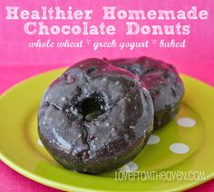 Homemade chocolate donuts made with whole wheat flour and Greek yogurt.  Baked in the oven, no frying. Moist, delicious healthier donuts ::Love From the Oven blog
