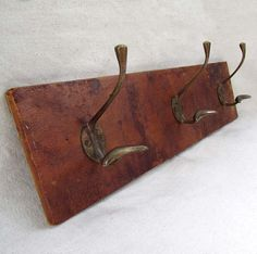 Vintage Leather and Brass Wall Mounted Coat Rack by edithandolive