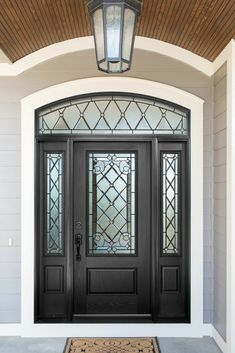 Fiberglass doors are an excellent choice for front doors, they mimic the grain of authentic wood doors but without the high maintenance. [Fiberglass Doors, Windowed Doors, Side Windows On Front Door, Front Door Ideas, Porch Door Ideas, Entryway Ideas, Exterior Design, Siding Exterior House]