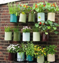 Fight the urge to buy new pots for your garden, buy some paints instead and recycle, hang and plant. Watering is a breeze if your back wall can take a spray or two each week.  http://design-milk.com/milkweed-spring-greens/?utm_source=feedburner_campaign=Feed%3A+design-milk+%28Design+Milk%29