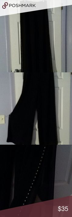 Pants Wide leg flowing pants with split on each side from thigh to foot. Worn once has rhinestones down each side can wear this out on date or night on the town. Pants Wide Leg