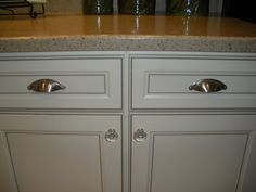 Crystal Knobs & cuffs for pulls.. love it! The cabinets are Aristokraft - Durham in Toasted Almond.