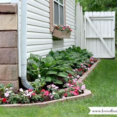 Create curb appeal by adding a neat & colorful side garden, shutters & a window box.