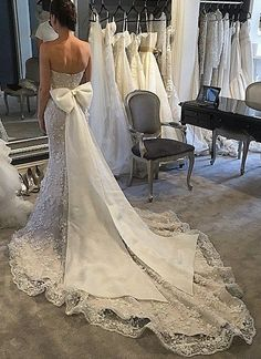 Steven Khalil= I now what a big bow on the back of my dress! :)