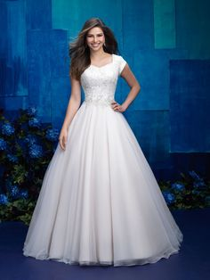 modest wedding dress in aline or ballgown shape for lds wedding. lace and english net/tulle wedding dress with cap sleeves, perfect for temple wedding.