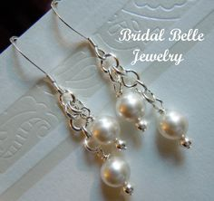 A personal favorite from my Etsy shop https://www.etsy.com/listing/105702793/classic-pearl-wedding-earrings
