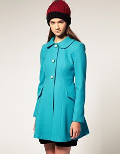 4) A bright-colored coat. From October through March, your coat is the first thing the world will see when you're out and about so why not make a statement with one in a fun color?
