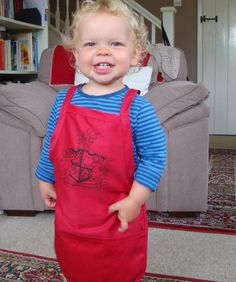 Choccywoccydoodah apron - For all you budding Choccywoccylatiers, a polycotton apron with useful pockets   This is a practical, polycotton apron, with front pockets and adjustable waist ties available in 3 sizes.  Here we have our lovely little junior apron modelled by the gorgeous Sam , 35 cm (w) x 43 cm (h)   Next modelled by the lovely Jack is our small adult size 50 cm (w) x 62 cm (h).  And finally our adult apron modelled by the lovely Daveed 69 cm (w) x 104 cm (h).