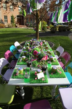 grass placemats and glass centerpeice - garden fairy party table