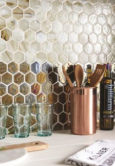 How gorgeous are these irridescent glass hexagonal mosaics by Original Style! The perfect way to introduce a note of luxury to a kitchen.