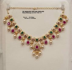 Presenting here is Necklace studded with rubies and emeralds. Necklace with south sea pearl hangings.Contact no 03 January 2019 Presenting here is Necklace studded with rubies and emeralds. Necklace with south sea pearl hangings.Contact no 03 January 2019 Jewelry Design Earrings, Gold Earrings Designs, Gold Jewellery Design, Necklace Designs, Gold Designs, Bridal Jewelry, Beaded Jewelry, Emerald Jewelry, Gold Jewelry Simple