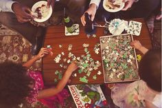 They put out a jigsaw puzzle at the backyard wedding reception.  Love it!