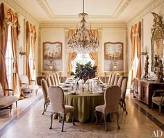 At a home in Houston, the dining room's Georgian chairs are covered in a Nancy Corzine velvet, the antique canvas panels on the far wall are from Mac Maison, and the chandelier is original to the house. | Architectural Digest