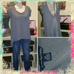 WELCOME TO SUMMER shirt Grayish plum color. So pretty to dress up or down, khakis, jeans, white capris ANYTHING. Shorts are not included. A relaxed fit. A greyish dusty plum color American Eagle Outfitters Tops