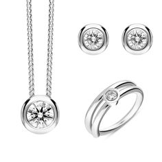 18ct White Gold Diamond Three Piece Gift Set, BLC-215 At C W Sellors, we have an expert team of diamond specialists who handpick and grade each jewel to meet our high standards and a team oftalented in house designers who combine their talents tobring you our exclusive Diamond collection. Chosen for their rare white quality, eachdiamond we use has a minimum clarity of VS and minimum colour of G-H. This beautiful gift set comprises: Pendant: Diamond Round Brilliant 0.31cts, sold complete… Jewelry Gifts, Jewellery, Christmas Gift Sets, High Standards, Rose Gold Jewelry, Jewelry Packaging, White Gold Diamonds, Natural Gemstones, Clarity