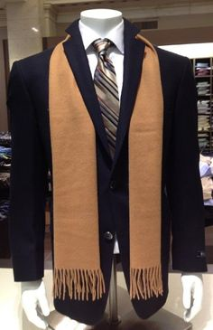 Men's Wearhouse  We were working on some styles in our flagship store today in San Francisco. A Hart Schaffner Marx navy sport coat is matched with a striped, silk tie and a 100% Egyptian cotton wide spread collar shirt. A 100% cashmere camel scarf adds more color for a bolder look. Did you know: Hart Schaffner Marx hand sets their sleeves to ensure the perfect fit and a natural feel around your shoulders.