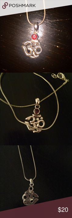 Sterling silver Om necklace with garnet stone Beautiful sterling silver Om pendant with garnet stone. Chain was added by me and I am not certain it is sterling. Thanks for looking Jewelry Necklaces