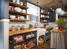 """""""There's too much opportunity for messy shelves — instead, keep a good proportion of closed doors so you can hide the chaos,"""" Weitzman says. If you're stuck with open shelves, cull your collection (do you really need all those souvenir mugs?) and hide clutter in prettier storage bins."""