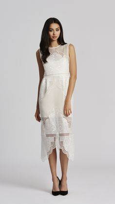 this delicate sheer lace dress boasts intricate musical note embroidery and acts as one of the main inspirations for the cruise collection. the fabric is the...