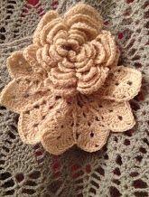 Crochet flower as broach on crochet sweater