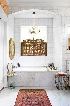 Carrara marble, white subway tile, and multiple mirrors brighten up the master bathroom. | Pinned to Nutrition Stripped | Home
