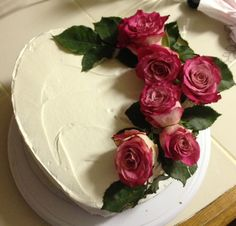 Valentines cake. Vanilla bean and strawberry filled with roses on top