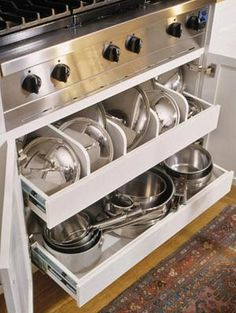 pots and lids drawer--like the placement under the range