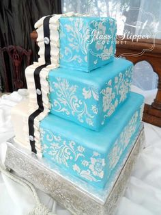 two toned wedding cake with ruffled ribbon