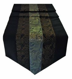 """Table Runner Thai Silk & Cotton - Black Color by Siamfabrics. $26.99. Stunning Table Runner Thai Silk and Cotton Mix. Made in Northern Thailand. Beautiful Center Elephant Design. Concealed Stitching. The underside is in a plain Black color. Length 79""""  Width 13.5"""". All these table runners are made for us by local people here in Chiang mai northern Thailand, famous for its Elephants and Silk fabrics, a mix of Silk and Cotton are used, the cotton will give it durability ..."""