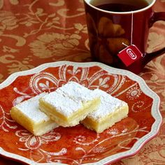 Another Rock Recipe I have to try since me loooove lemon!  I haven't made any of their recipes yet that didn't rock my world.    Rock Recipes -The Best Food & Photos from my St. John's, Newfoundland Kitchen.: Easy Lemon Squares