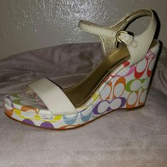 Coach Multi Colored Wedges Coach Multi Colored Wedges. These are a Re-Posh. They are soooo cute,  they are just a bit too small for me! Coach Shoes Wedges