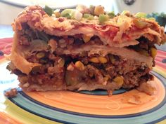 Mexican casserole - layer corn tortillas with a lean ground turkey and veggie taco flavored mix and light shredded cheese with salsa... Bake and slice to enjoy!! #creative #mexicanfood #healthy
