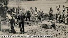 """""""On the back of the photo is written, """"Nazi Party members digging up American bodies at Berga."""" Berga an der Elster was a slave labor camp where 350 U.S. soldiers were beaten, starved, and forced to work in tunnels for the German government. The soldiers were singled out for """"looking like Jews"""" or """"sounding like Jews,"""" or dubbed as undesirables, according to survivors. More than 100 soldiers perished at the camp or on a forced death march."""""""