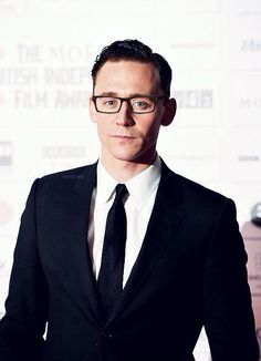 Tom. With glasses. He could totally play Clark Kent!