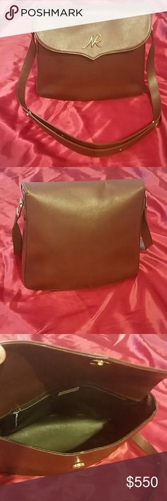 *Vintage! Nina Ricci Brown Handbag-S Vintage. Gently loved throughout the years. Amazing condition for its age. There are a couple spots of makeup inside. It'll come right off with an oil based remover. I don't attempt it myself when selling, I'm a clutz. Haha! So, you can see it in pic 3 a bit. No rips or tears. Adjustable shoulder strap. It has durable and beautiful hardware. The front has a NR. The leather is super thick and durable too. Nice chocolate brown color. 1 pocket inside. Simple…