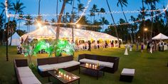 outdoor lounge and tented wedding reception in tropical location