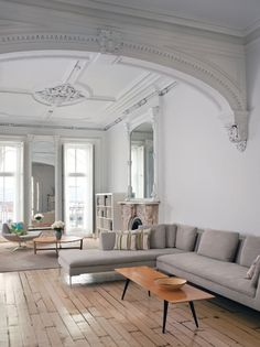 Tall wall, beautiful plaster work on the ceilings and walls /// House Envy: A Modern Brownstone
