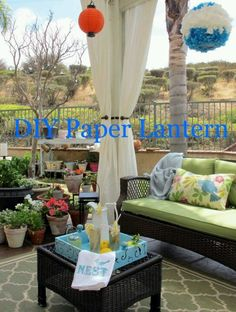 I am posting under DIY so those who want to make the lanterns.   However be sure to look at the decor..loving the turquoise accents..the tray could be a recycled serving piece