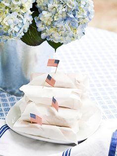 4th of July - Wrap Hot Dogs in Wax Paper and put a flag on top