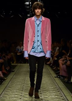 A rose pink jacket in soft velvet, cut for a slim fit, provides a contrast to the pyjama-style shirt and striped cotton shirt underneath, and is styled with slim fit regimental jeans.